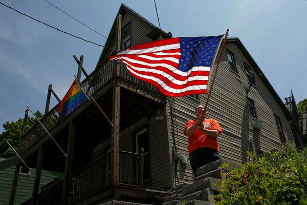Kate Lynn Blatt, a transgender woman, waves the U.S. flag outside her home in Pottsville, Pennsylvania, on May 25, 2016. Blat