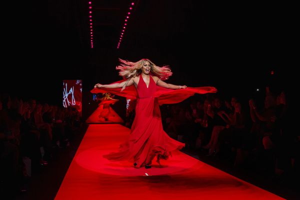 Actress Laverne Cox walks in a Donna Karan creation during a presentation of the Go Red for Women Red Dress collection during