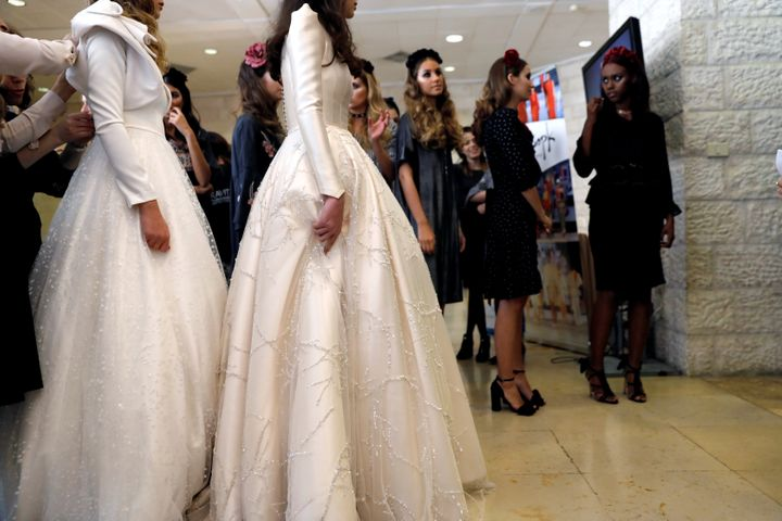 "Models prepare backstage during an event dubbed, ""Modest Fashion Day"", the first of its kind in Israel, whereby designers showed off their clothing creations aimed at Orthodox Jewish women who adhere to strict dress codes."
