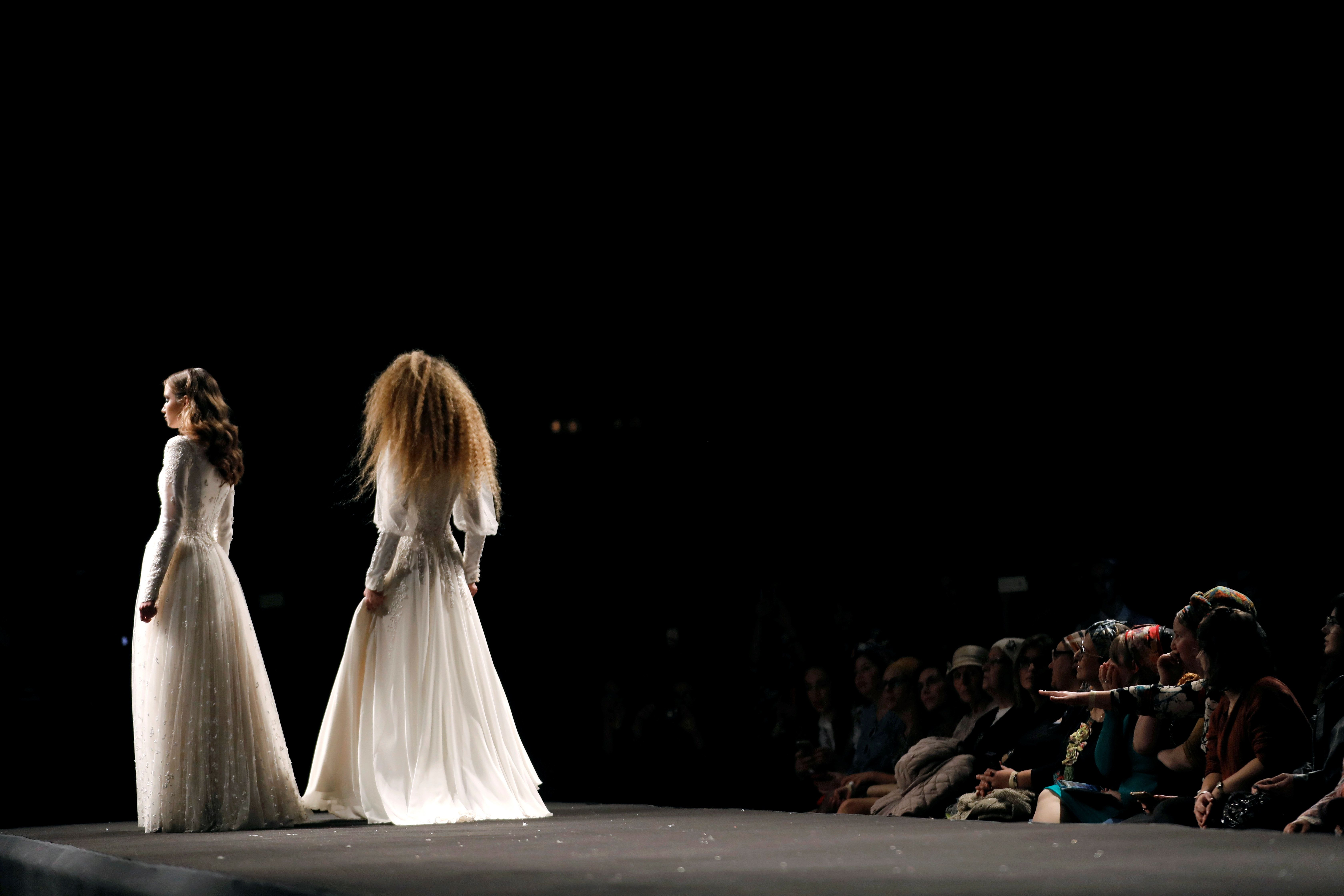 "Models stand on the runway during an event dubbed ""Modest Fashion Day."""