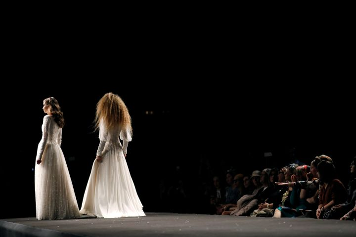 """Models stand on the runway during an event dubbed """"Modest Fashion Day."""""""
