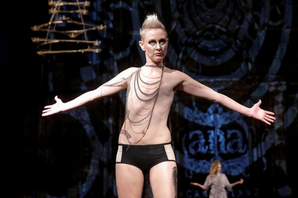 Vonn Jensen, a non-binary trans person, presents creations from the AnaOno collection, a show modeled by members of the group
