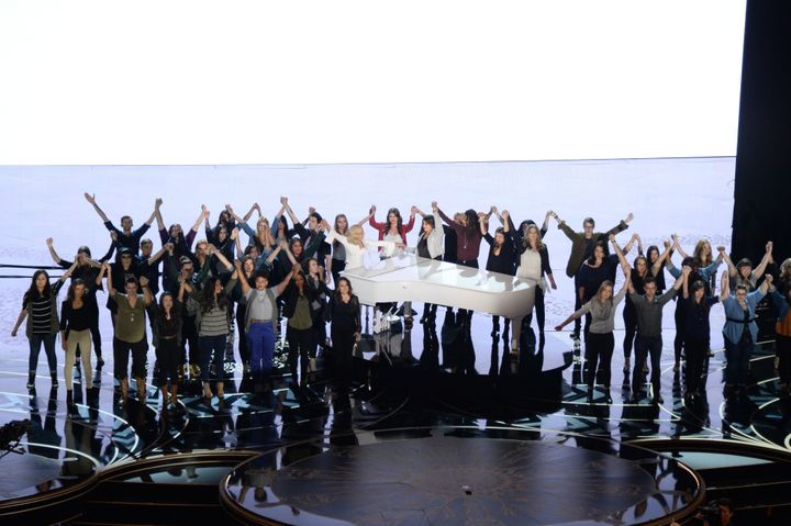 Lady Gaga with sexual assault survivors at the Academy Awards.