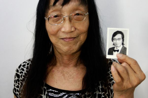 """Qian Jinfan, an 84-year-old transsexual who prefers to be addressed as """"Yiling,"""" holds up a photo taken at the age of 59, in"""