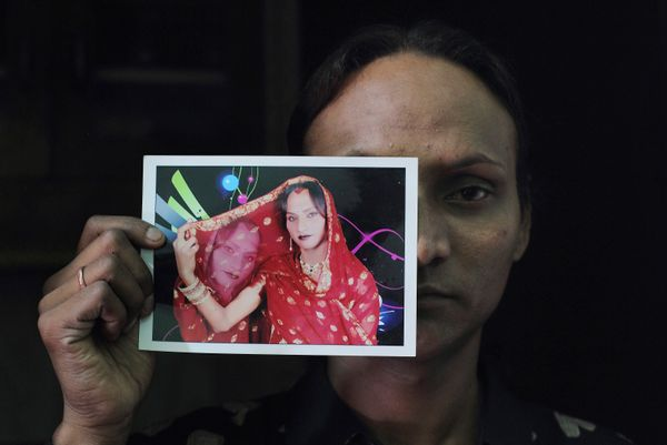 Seema, 33, displays a picture in which she's dressed as a woman at her residence in New Delhi, India, on May 16, 2012. Seema