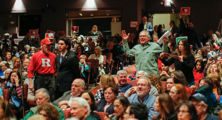 People react in agreement to a question posed to New Jersey Republican Congressman Leonard Lance during a town hall meeting a