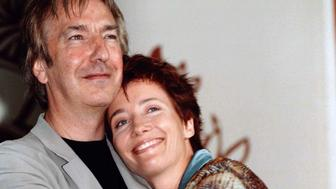 """British actor Alan Rickman (L) embraces actress Emma Thompson during a photo call at the 54th Venice Film Festival, August 28. Rickman makes his debut as a director in the human drama """" The Winter Guest"""", starring Oscar-winner Emma Thompson, one of 18 films showing at the Venice Film Festival.  ITALY FILM FESTIVAL"""