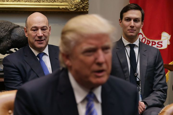 From left to right, Gary Cohn, President Donald Trump and Jared Kushner sit in the Roosevelt Room at the White House, Ja