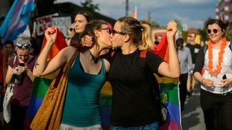 Women kiss as they take part in the Ljubljana Pride Parade in Ljubljana, Slovenia, on June 18, 2016. / AFP / JURE MAKOVEC        (Photo credit should read JURE MAKOVEC/AFP/Getty Images)