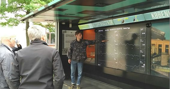An open-air digital dashboard display in Central Copenhagen providing read-outs of street air quality monitoring devices.