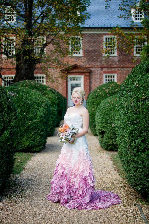 "<i>Dress by <a href=""http://www.emmalinebridal.com/"" target=""_blank"">Emmaline Bridal</a></i>"