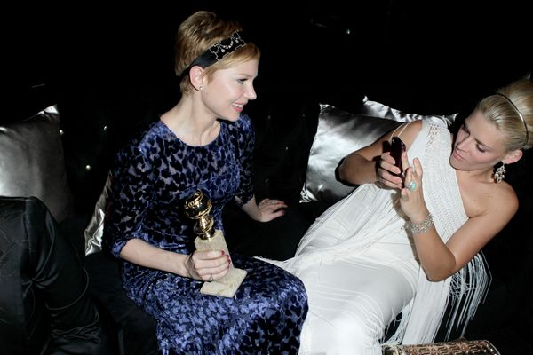 <strong>Jan. 15, 2012:</strong> Michelle Williams and Busy Philipps at The Weinstein Company's Golden Globes after-party.