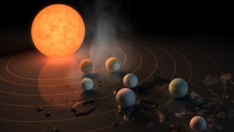 UNSPECIFIED:  In this NASA digital illustration handout released on February 22, 2017, this artist's concept will appear on the February 23rd, 2017 cover of the journal Nature announcing that the TRAPPIST-1 star, an ultra-cool dwarf, has seven Earth-size planets orbiting it. Any of these planets could have liquid water on them. Planets that are farther from the star are more likely to have significant amounts of ice, especially on the side that faces away from the star. The system has been revealed through observations from NASA's Spitzer Space Telescope as well as other ground-based observatories, and the ground-based TRAPPIST telescope for which it was named after. (Photo digital Illustration by NASA/NASA via Getty Images)