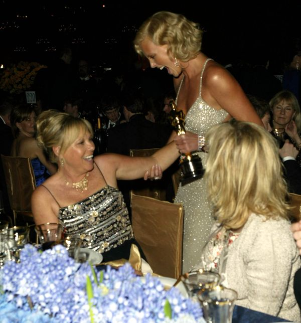 <strong>Feb. 29, 2004: </strong>Charlize Theron spotting her mother at the Governors Ball.