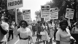 The civil rights march on Washington with a procession of African Americans carrying signs for equal rights and integrated schools, Washington DC, August 28, 1963. (Photo by Warren K Leffler/Underwood Archives/Getty Images)