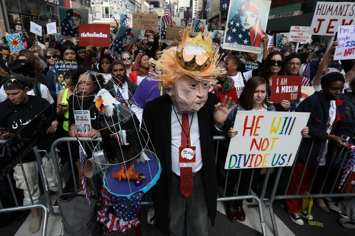 "A man dressed as Trump takes part in the ""I am Muslim Too"" rally in Times Square."