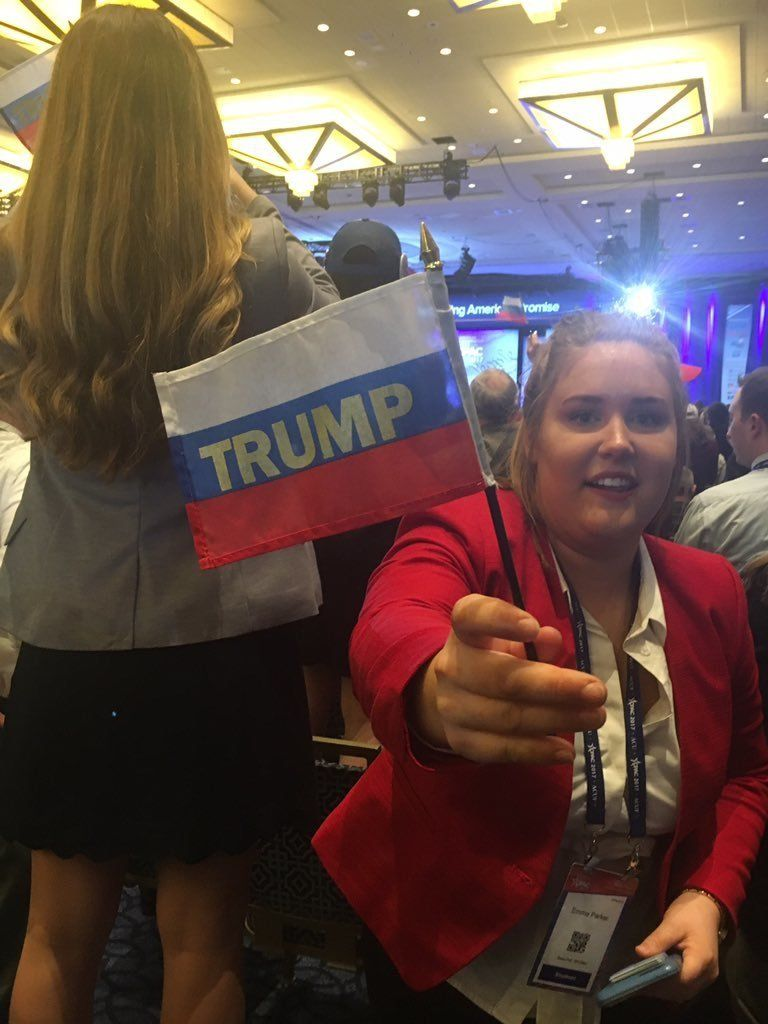 CPAC-er waves Trump Russian flag before the president speaks at the conservative confab