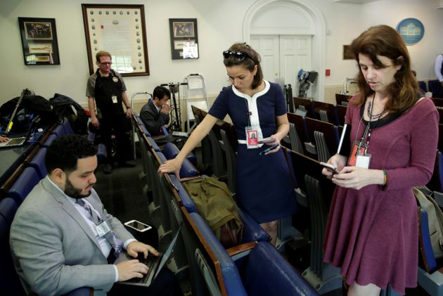 Journalists work in the briefing room at the White House on