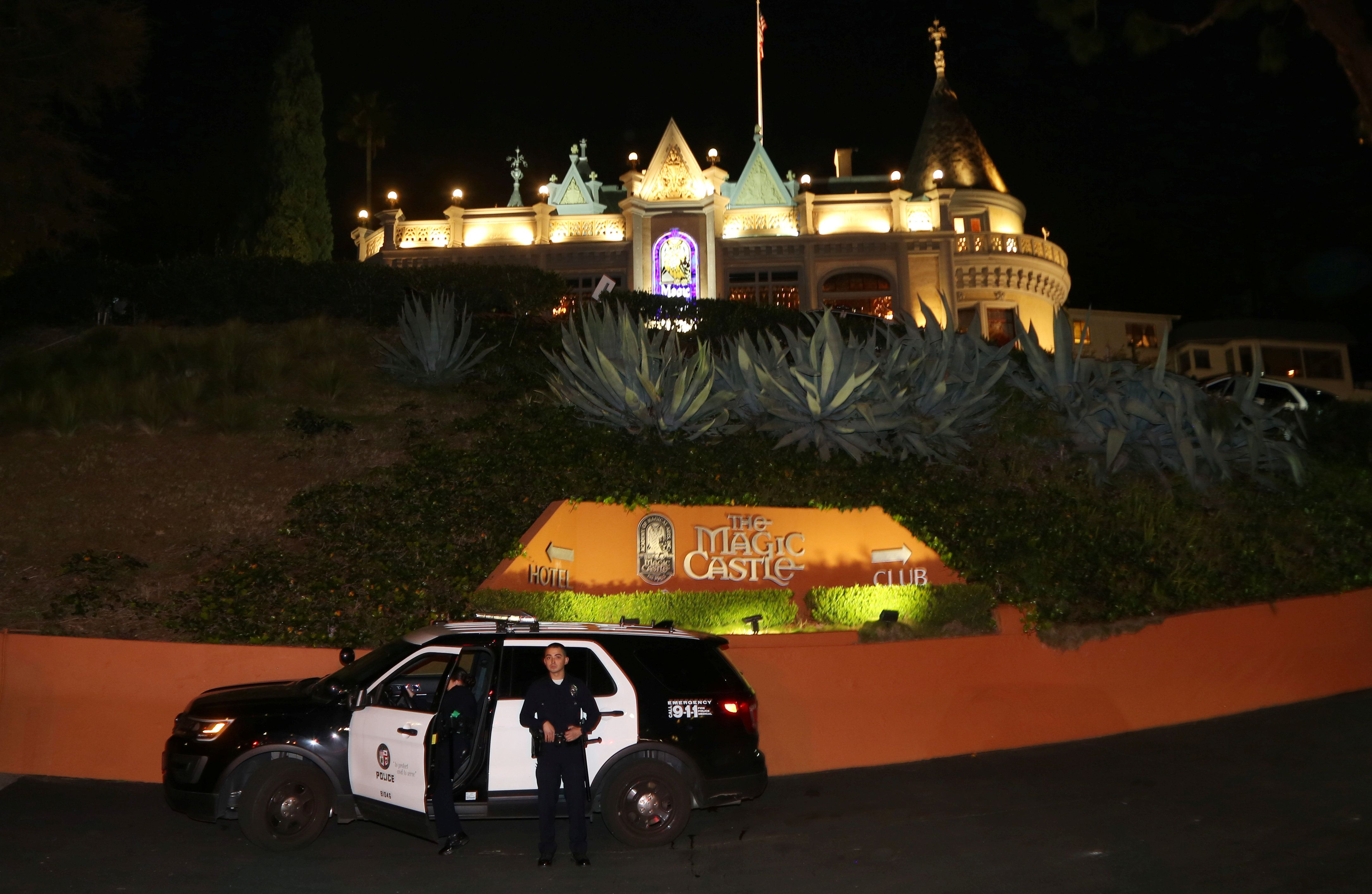 Los Angeles Police Department officers are seen outside of the Magic Castle magicians' club in Hollywood, California, on Frid