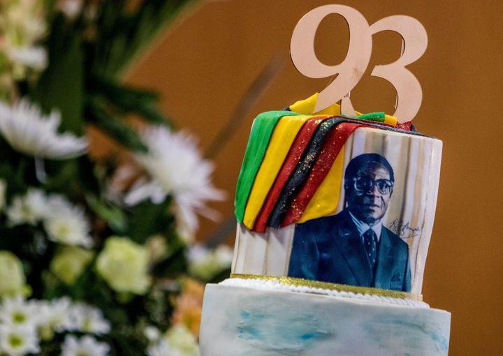 Abirthday cake bears a portrait of Zimbabwe's President Robert Mugabe.
