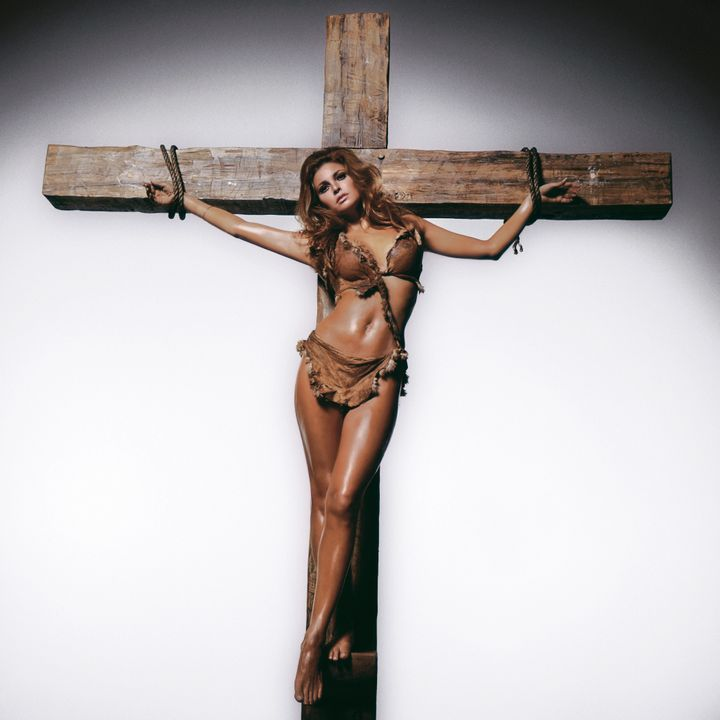 "American actress Raquel Welch being crucified in the fur bikini she wore in ""One Million Years BC."""