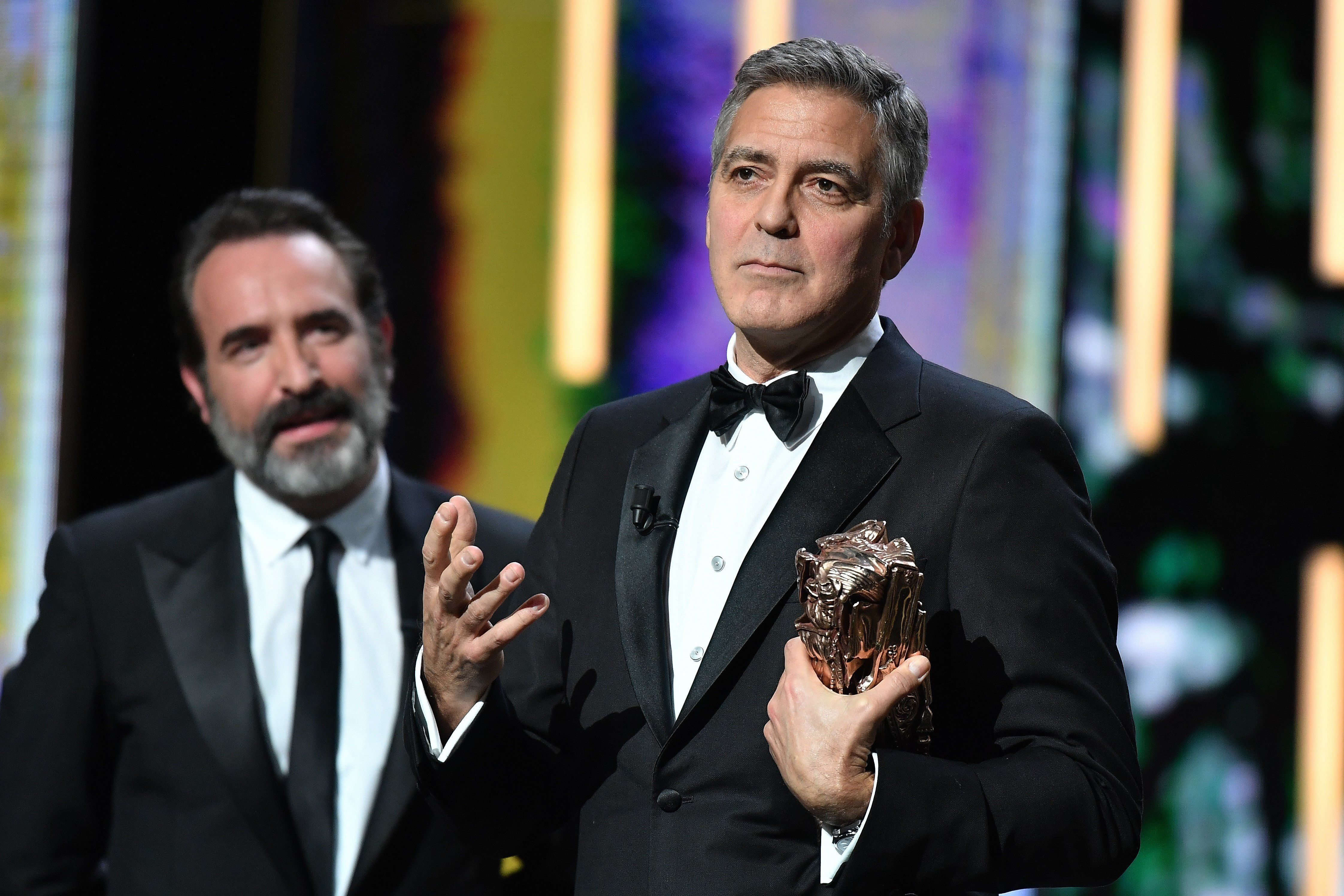 PARIS ,FRANCE-FEBRUARY 24: Actor George Clooney delivers a speech next to actor Jean Dujardin as he receives an Honorary Cesar Award at the 42nd Cesar Awards ceremony at Salle Pleyel in Paris, France on February 24, 2017.   (Photo by Philip Rock/Anadolu Agency/Getty Images)