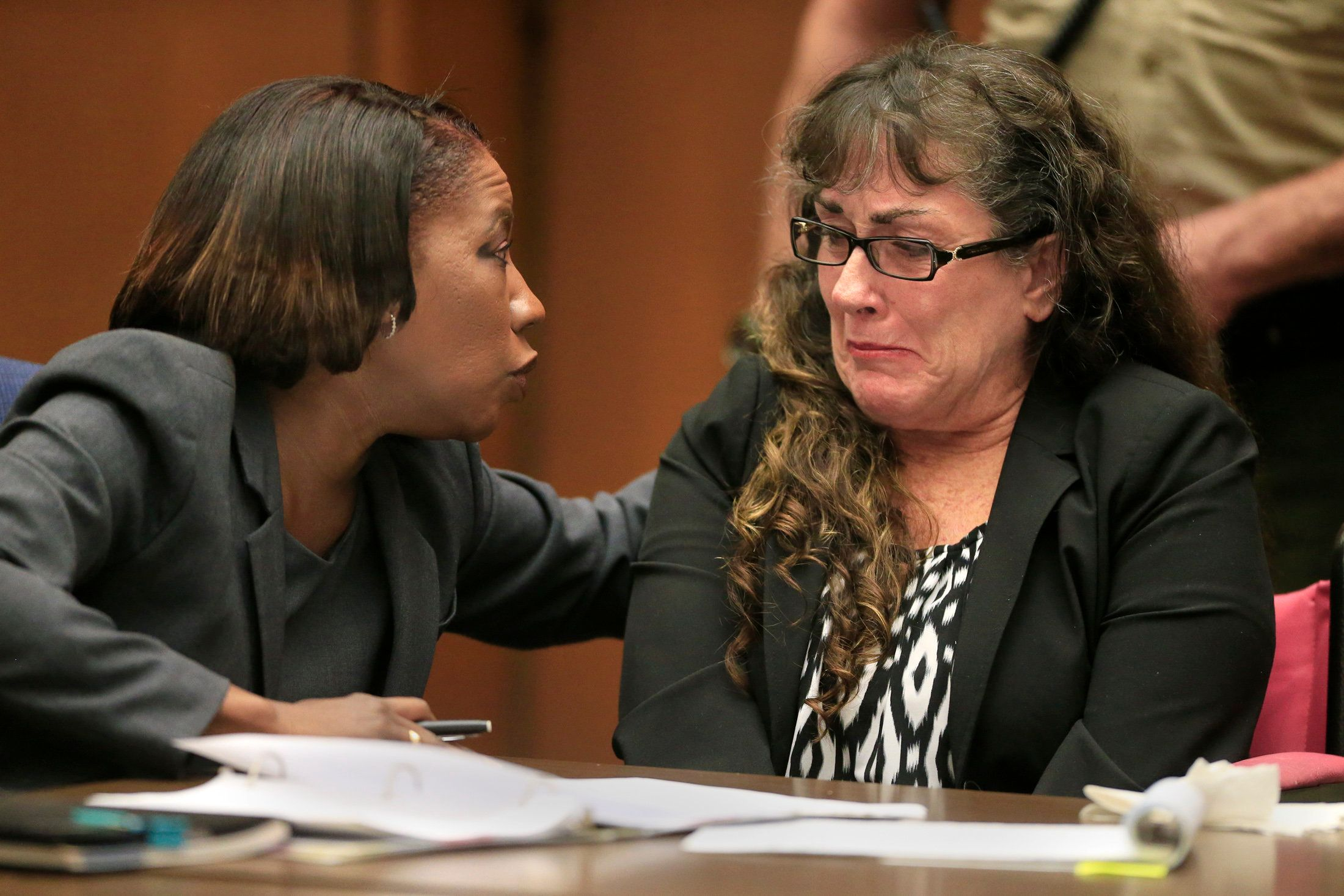 LOS ANGELES,CALIFORNIA, JUNE 12, 2014:  (Left to right) Public Defender Nan Whitfield comforts Sherri Lynn Wilkins, a substance abuse counselor who received a sentence of  55-years-to-life after being convicted of murder and for driving drunk in the death of 31-year-old Phillip Moreno. Wilkins hit Moreno then drove for about two miles with the victim embedded in her windshield June 12, 2014 (^^^ / Los Angeles Times ).  (Photo by Mark Boster/Los Angeles Times via Getty Images)