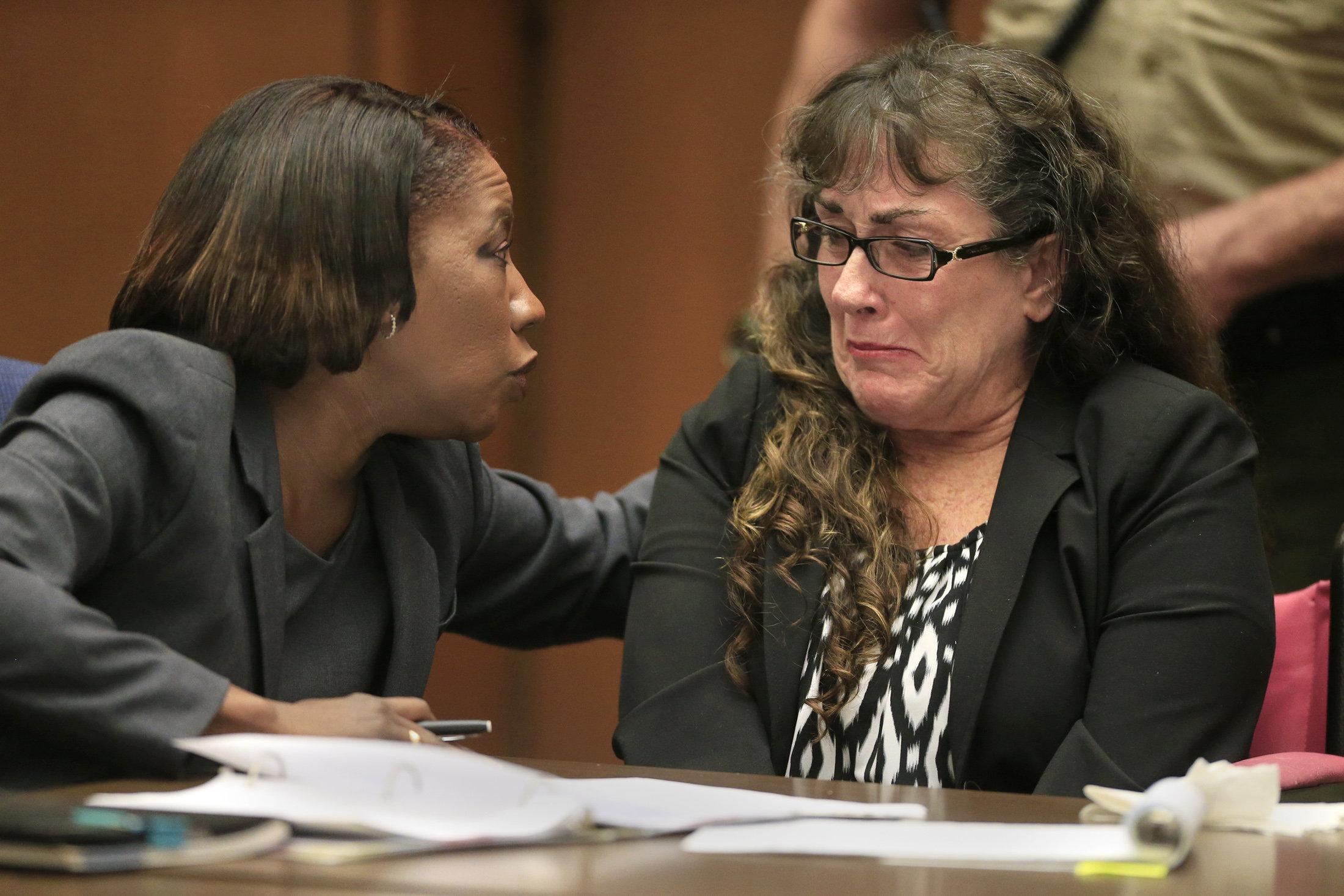 Public defender Nan Whitfield comforts substance-abuse counselorSherri Lynn Wilkins in 2014.