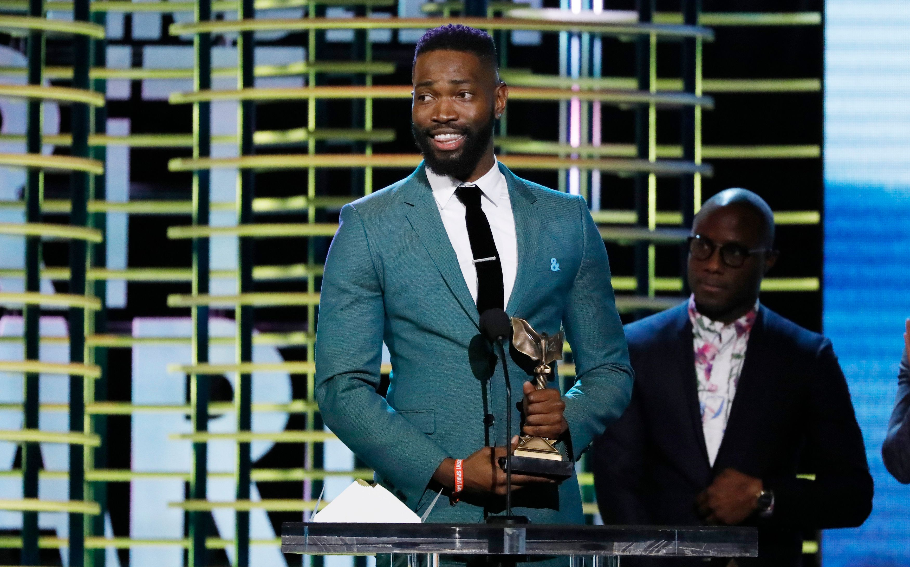 """Tarell Alvin McCraney (L) and Barry Jenkins accept the Best Screenplay award for the film """"Moonlight"""" at the 2017 Film Independent Spirit Awards in Santa Monica, California, U.S., February 25, 2017. REUTERS/Mario Anzuoni"""