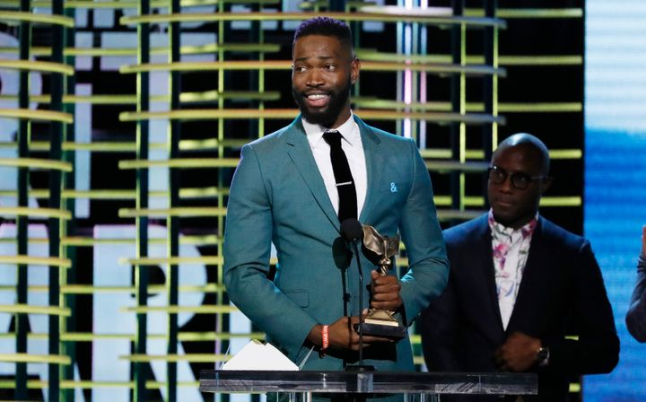"Tarell Alvin McCraney and Barry Jenkins accept the Best Screenplay award for ""Moonlight"" at the 2017 Film Independent Spirit"