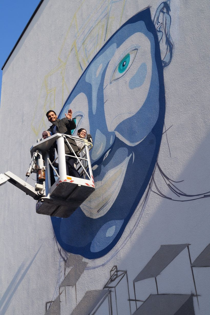 Members of the UN-Habitat Youth Advisory Board along with street artist David Wissing during the painting of this #UrbanActio