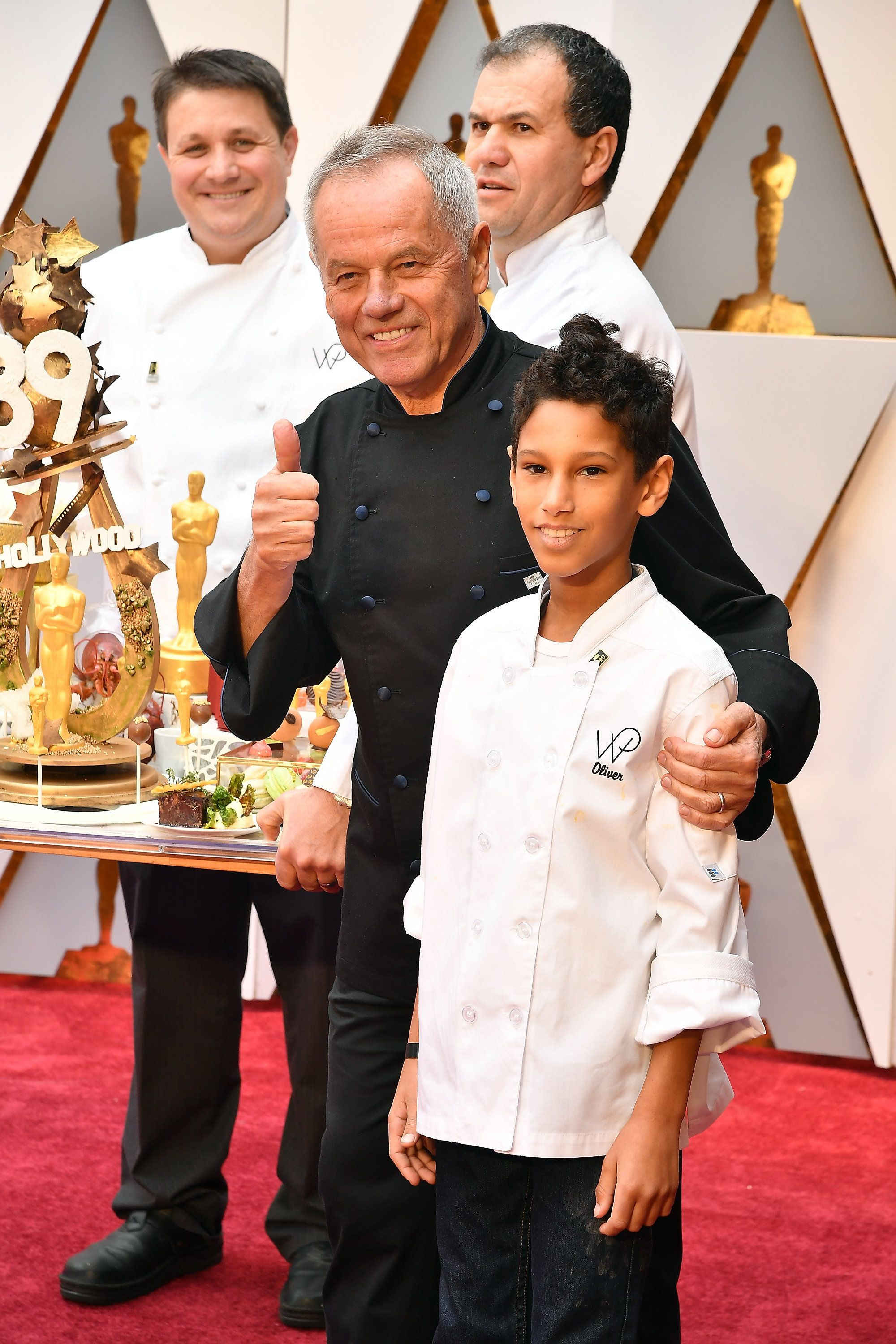 HOLLYWOOD, CA - FEBRUARY 26: Chef Wolfgang Puck (center) presents Oscar cuisine before the 89th Annual Academy Awards at Hollywood & Highland Center on February 26, 2017 in Hollywood, California.  (Photo by Jeff Kravitz/FilmMagic)