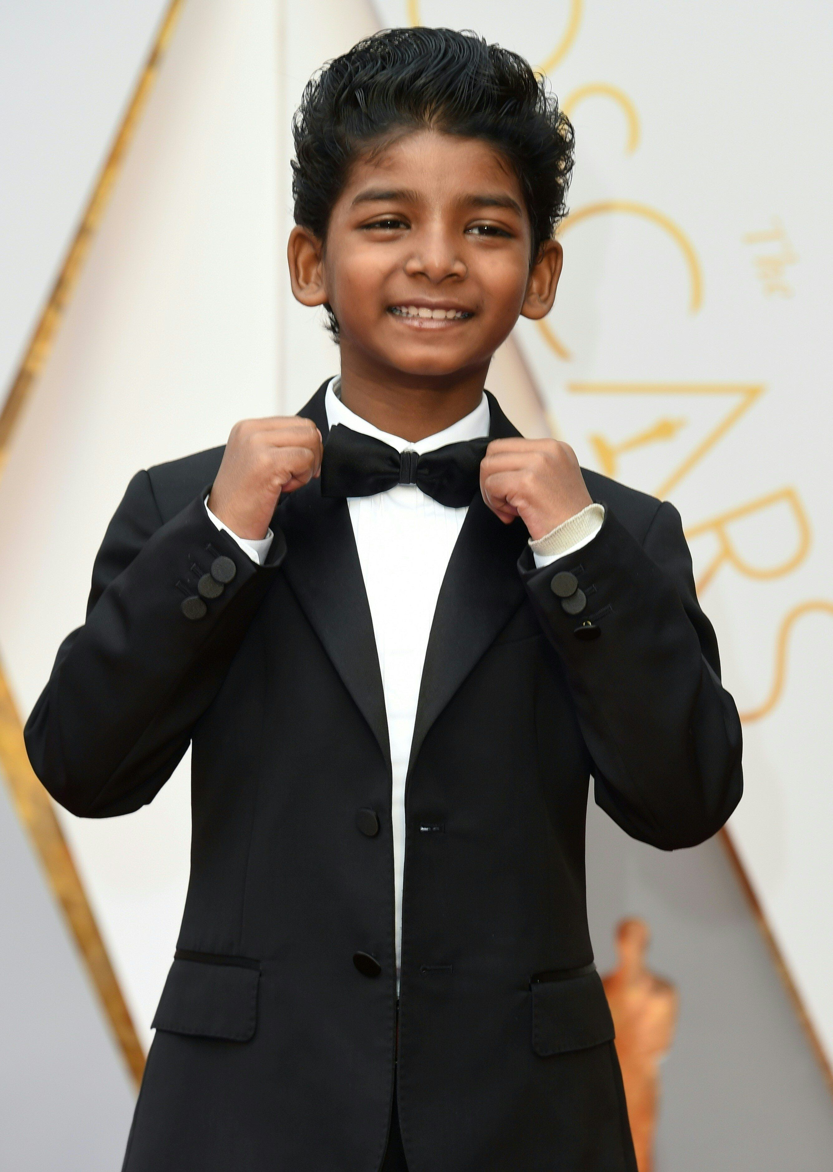 Sunny Pawar arrives on the red carpet for the 89th Oscars.