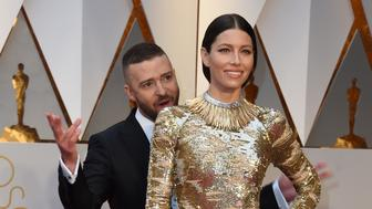 Nominees for Best Music (Original Song) 'Can't Stop The Feeling' from Trolls Justin Timberlake and his wife US actress Jessica Biel arrive on the red carpet for the 89th Oscars on February 26, 2017 in Hollywood, California.  / AFP / VALERIE MACON        (Photo credit should read VALERIE MACON/AFP/Getty Images)