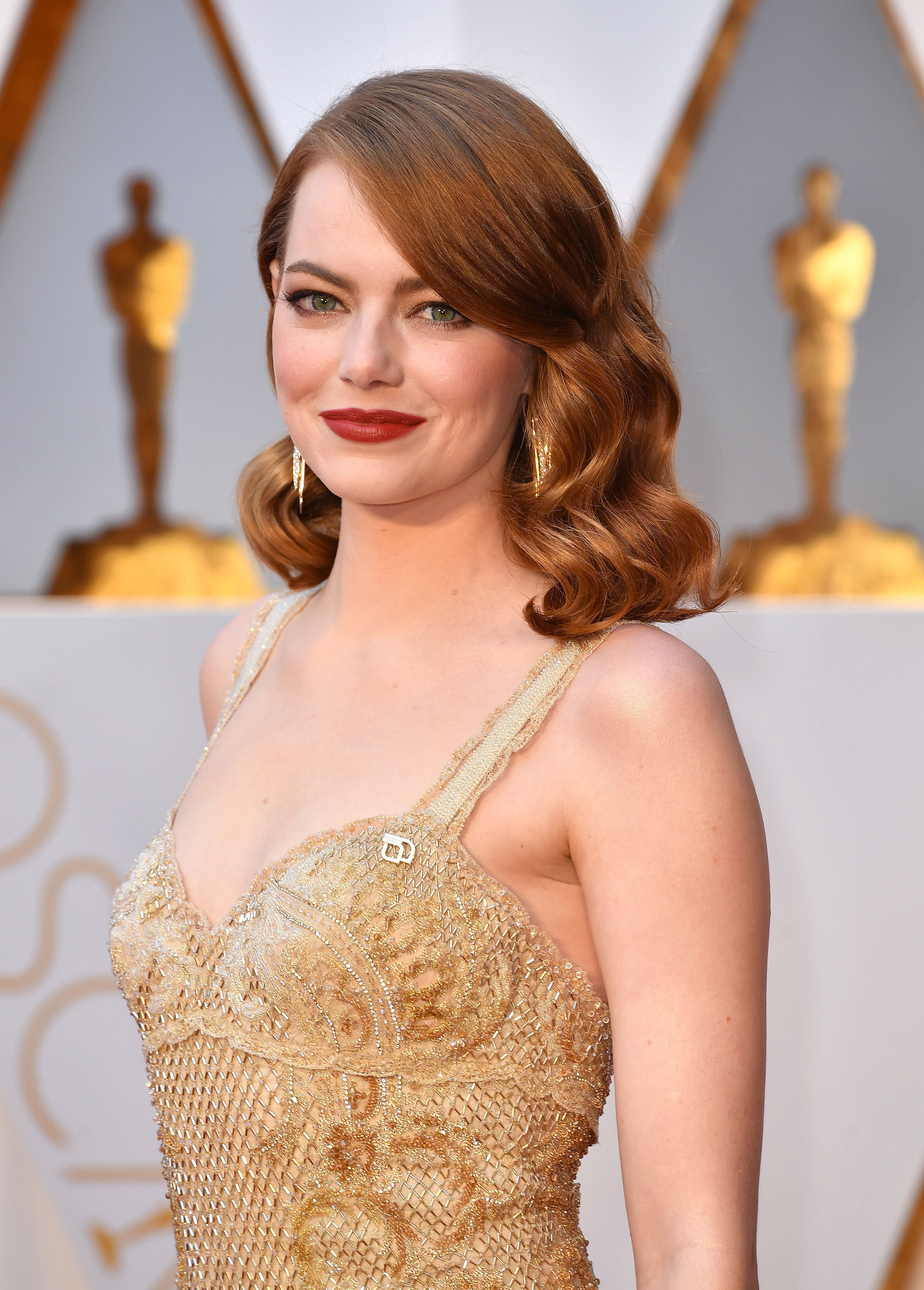 Emma Stone And Dakota Johnson Challenged The Oscars Statuette To A Style