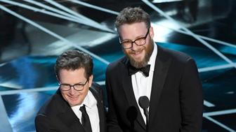 HOLLYWOOD, CA - FEBRUARY 26:  Actors Michael J. Fox (L) and Seth Rogen speak onstage during the 89th Annual Academy Awards at Hollywood & Highland Center on February 26, 2017 in Hollywood, California.  (Photo by Kevin Winter/Getty Images)
