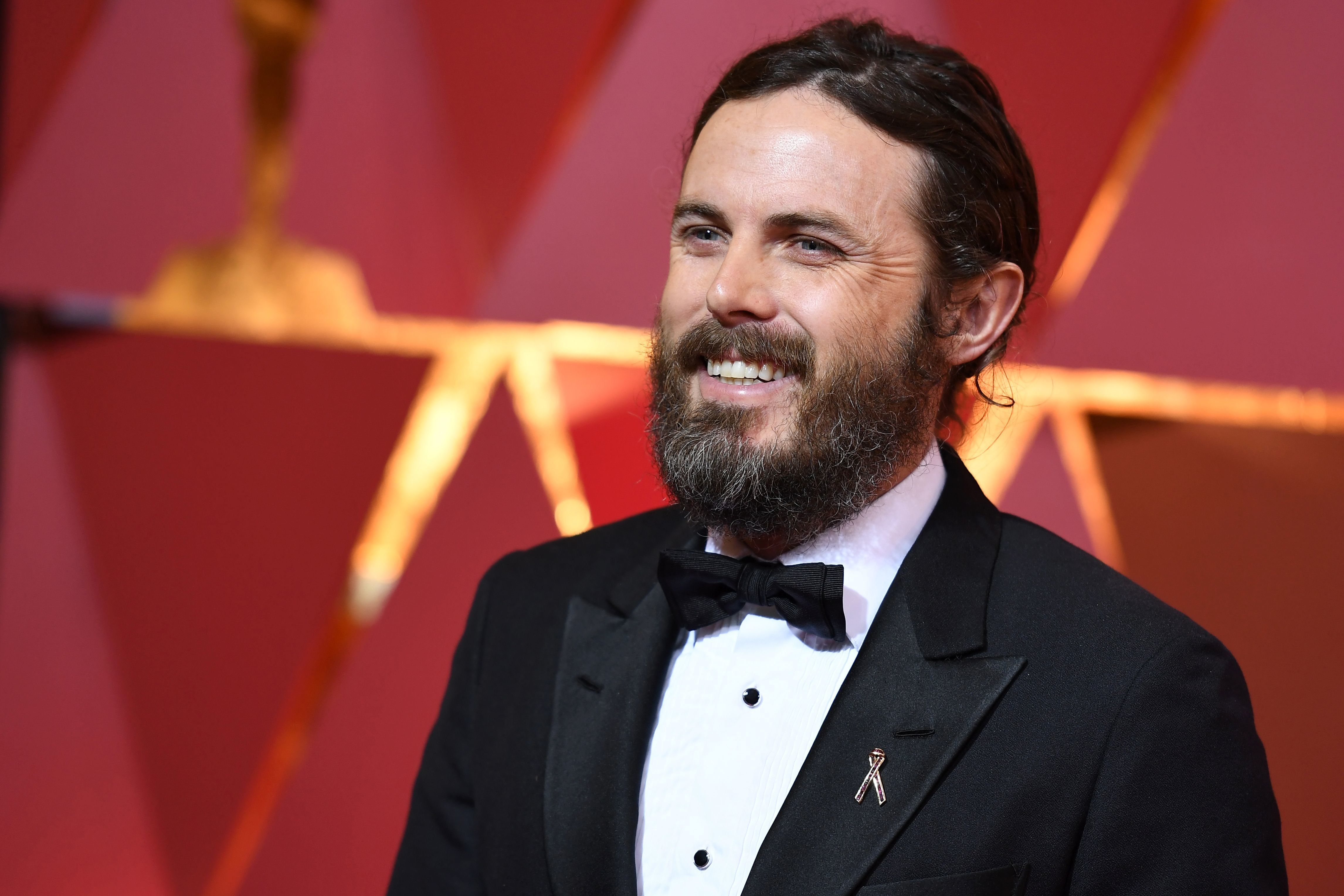Nominee for Best actor in 'Manchester By The Sea' Casey Affleck poses as he arrives on the red carpet for the 89th Oscars on February 26, 2017 in Hollywood, California.  / AFP / ANGELA WEISS        (Photo credit should read ANGELA WEISS/AFP/Getty Images)