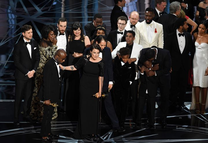 "The cast and crew of ""Moonlight"" accept the Best Picture award onstage Sunday night."