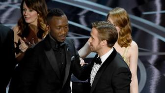 HOLLYWOOD, CA - FEBRUARY 26:  'Moonlight' actor Mahershala Ali with Ryan Gosling and Emma Stone after it was discovered 'La La Land' was mistakenly announced as Best Picture onstage during the 89th Annual Academy Awards at Hollywood & Highland Center on February 26, 2017 in Hollywood, California.  (Photo by Kevin Winter/Getty Images)