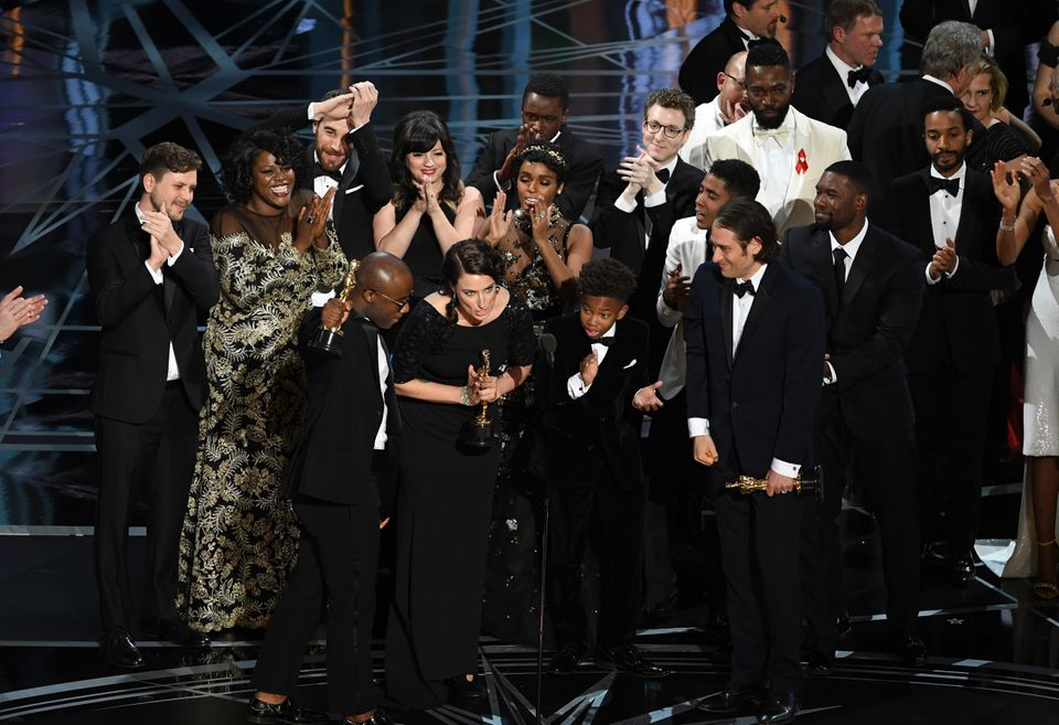 "Cast and crew of ""Moonlight"" accept the Best Picture award onstage during the 89th Annual Academy Awards at Hollywood & H"