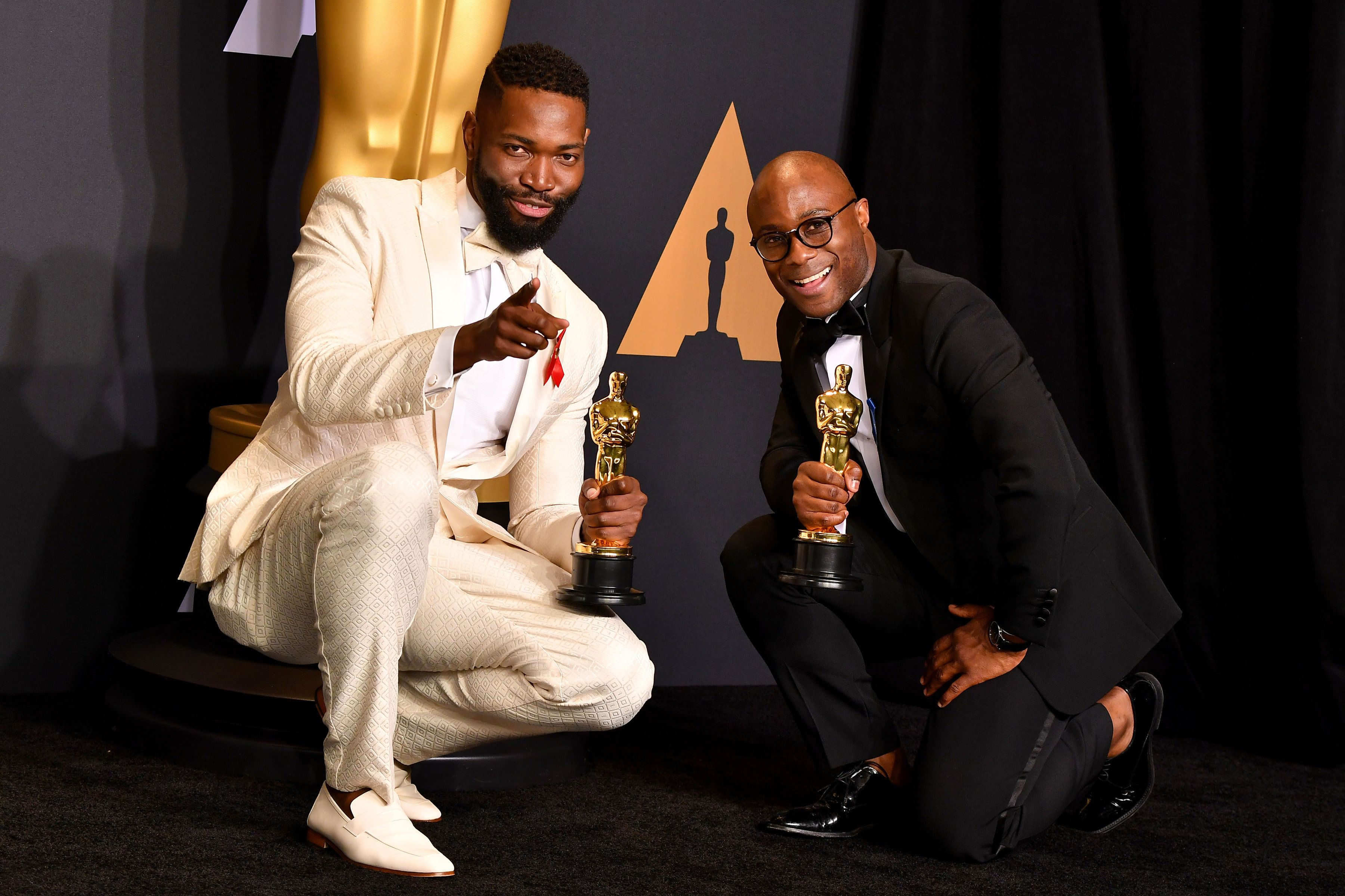 HOLLYWOOD, CA - FEBRUARY 26:  Screenwriter Tarell Alvin McCraney (L) and filmmaker Barry Jenkins, winners of the award for Adapted Screenplay for 'Moonlight,' pose in the press room during the 89th Annual Academy Awards at Hollywood & Highland Center on February 26, 2017 in Hollywood, California.  (Photo by Steve Granitz/WireImage)