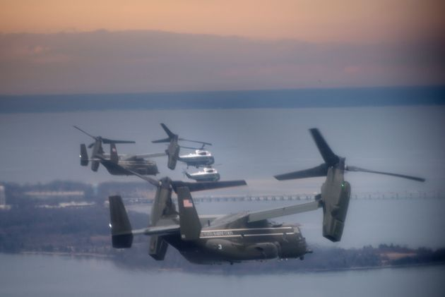 Marine One with US President Donald Trump flies with a decoy and support helicopters to Dover Air Force...