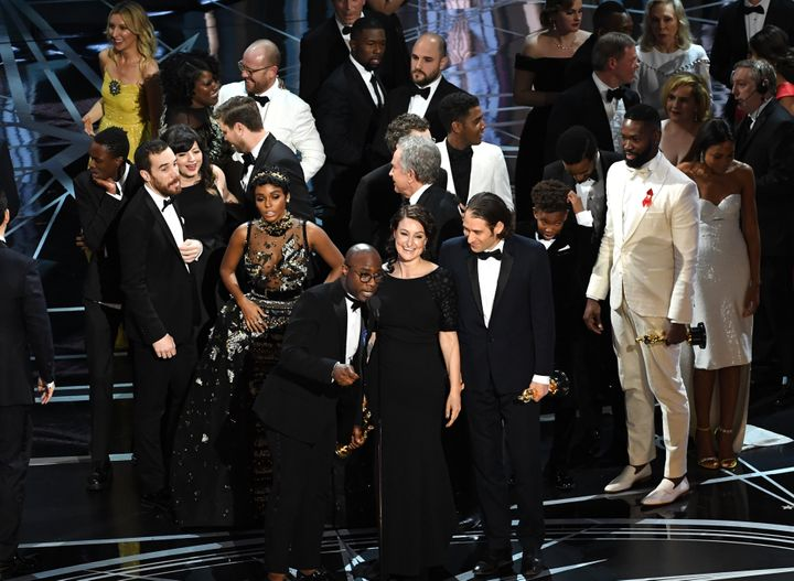 "Producer Adele Romanski, writer/director Barry Jenkins and producer Jeremy Kleiner accept the Best Picture Oscar for ""Moonlig"
