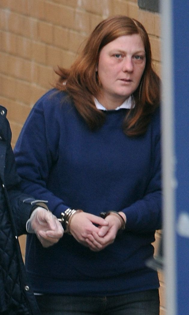 Karen Matthews is led from Dewsbury police station, before her court appearance in March