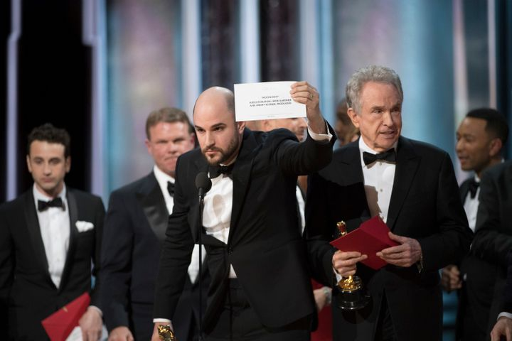 """""""La La Land"""" producer Jordan Horowitz holds up the card showing that """"Moonlight"""" had won the Oscar for best picture at the Academy Awards on Sunday."""