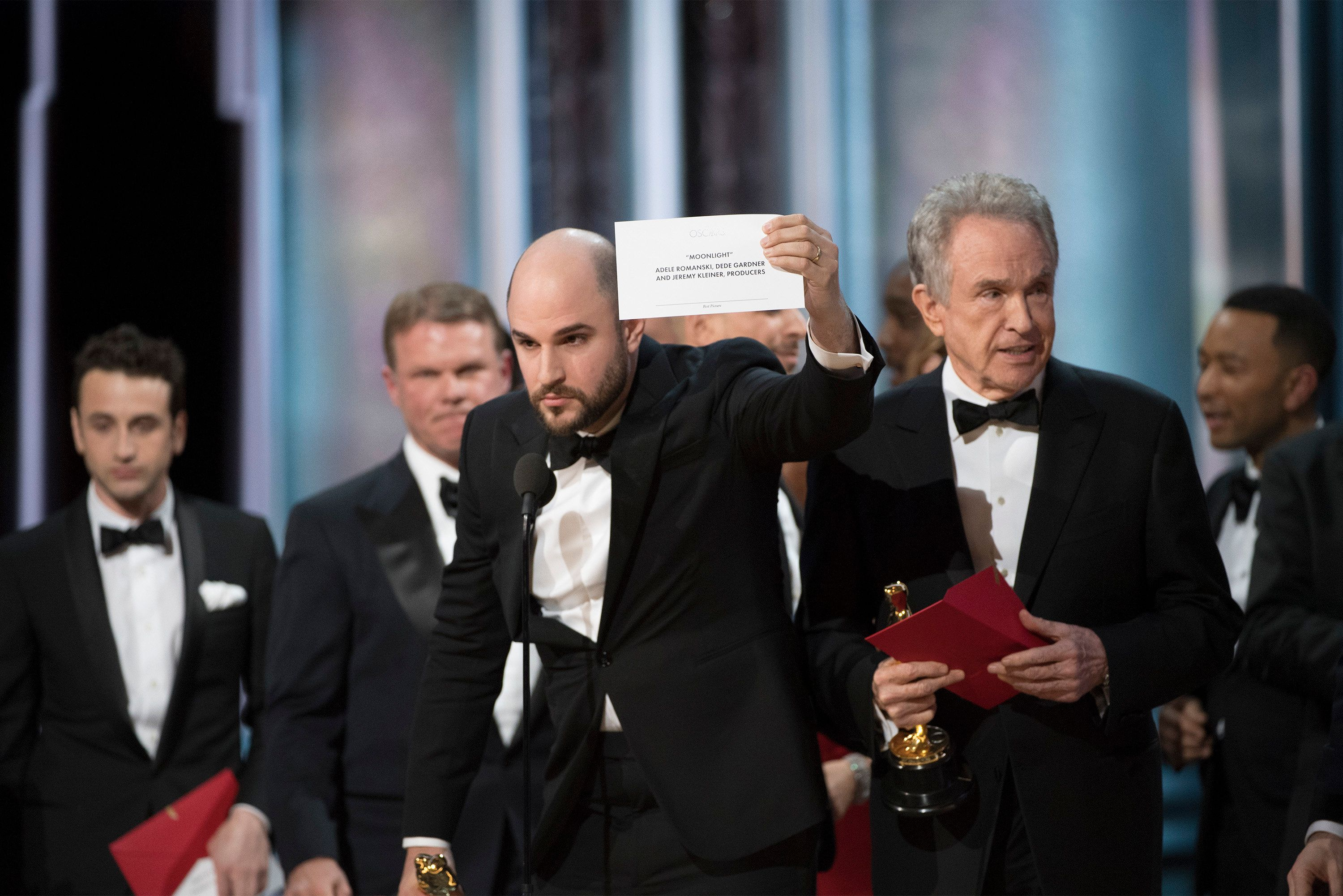 """""""La La Land"""" producer Jordan Horowitz holds up the card showing that """"Moonlight"""" had won the Oscar for best pictureat t"""