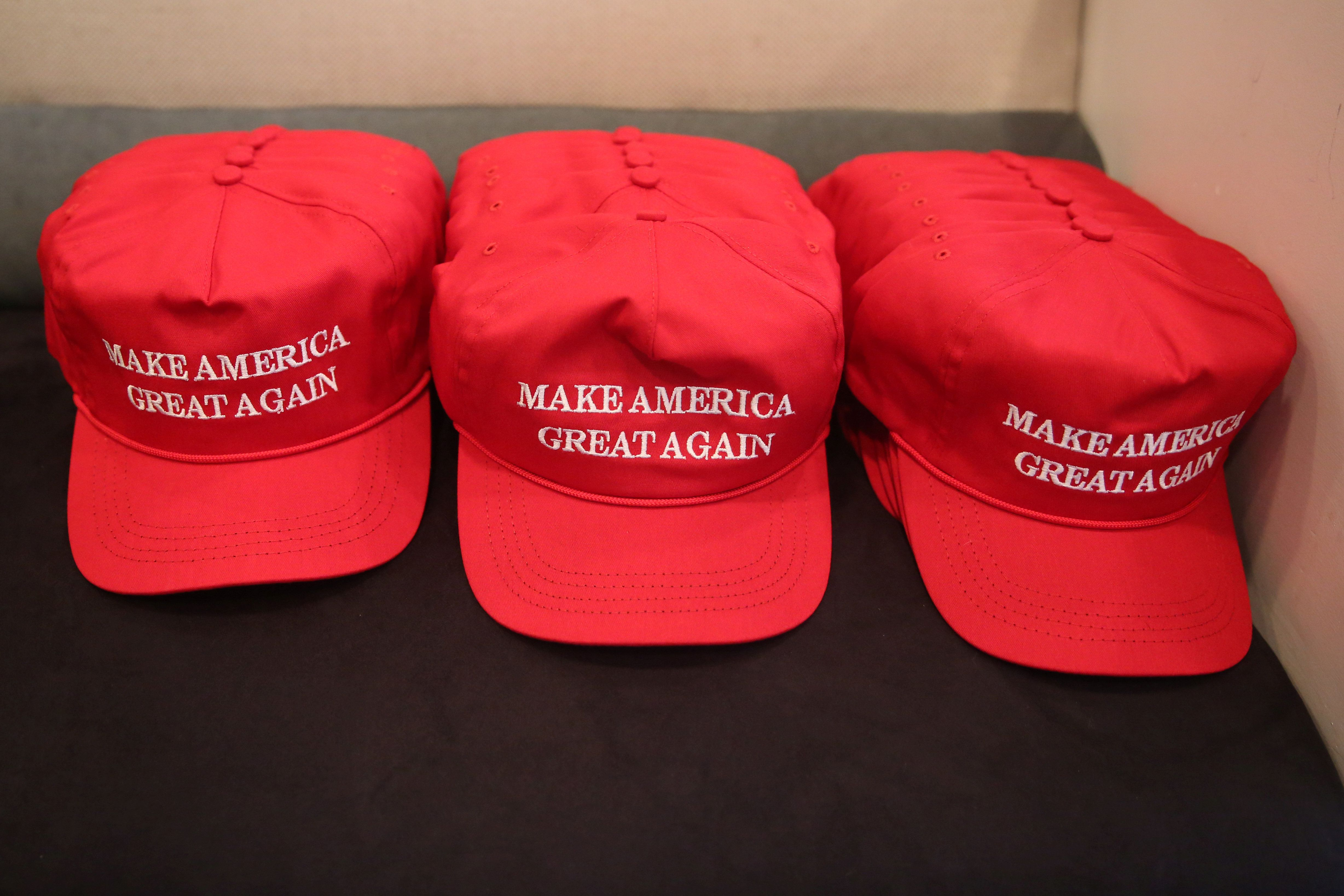 """Make America Great Again"" hats are pictured during a meeting with then GOP presidential nominee Trump's Hispanic Adviso"