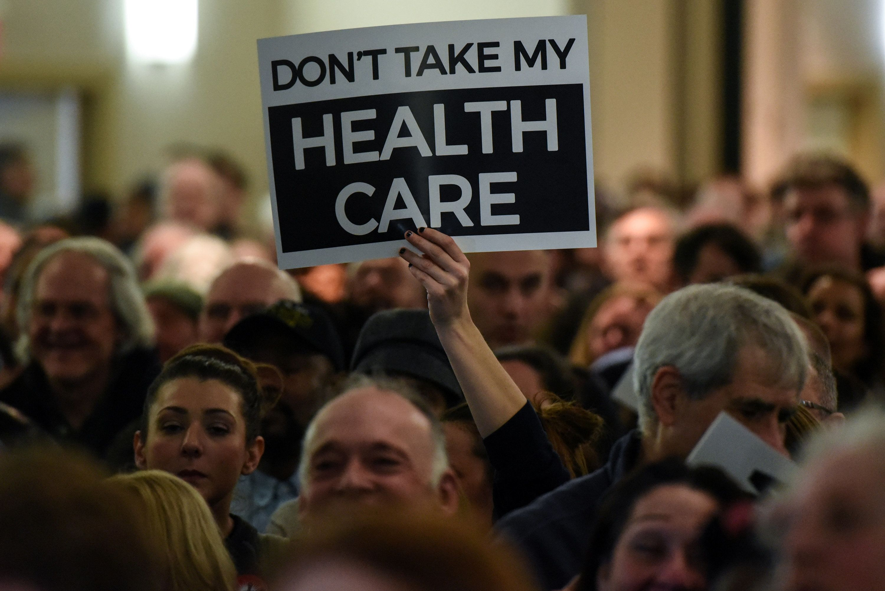 People demonstrate for the Affordable Care Act and against Trump during the First Stand Rally in Newark, N.J., U.S. January 15, 2017. REUTERS/Stephanie Keith