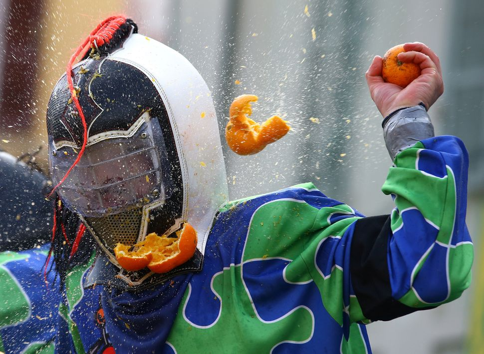 A participant is hit with an orange mid-battle.