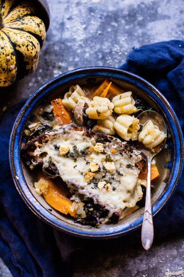 "<strong>Get the <a href=""https://www.halfbakedharvest.com/italian-pumpkin-kale-chicken-noodle-soup-fontina-toast/"" target=""_b"